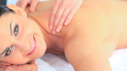 Darkhaired woman smiling while having a massage Stock Video Footage