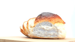 Sliced round white bread loaf rotating Footage