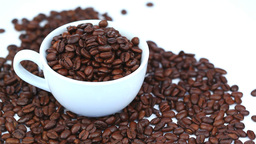Cup filled with coffee beans rotating Footage