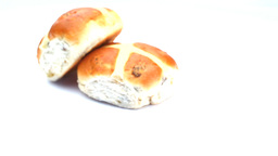 Two hot cross buns rotating Footage