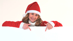 Young woman dressed up as Santa Claus Stock Video Footage
