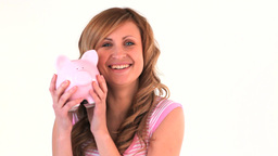 Cute woman posing with her piggy bank Footage