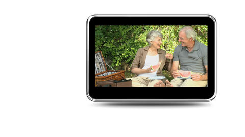 Montage of a retired couple relaxing outside Stock Video Footage