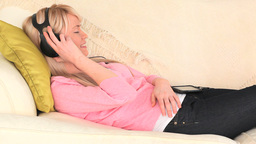 Attractive woman listening to music Footage