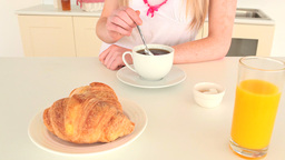 Young woman having breakfast Footage