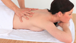 Darkhaired woman having a massage Stock Video Footage