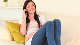 Attractive woman talking on the phone Stock Video Footage