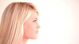 Attractive blond woman looking into the distance Stock Video Footage