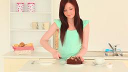 Beautiful brunette taking a slice of cake Footage