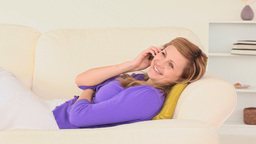 Relaxed woman talking on the phone Stock Video Footage
