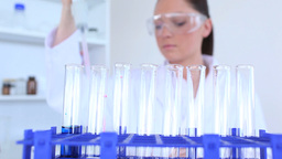 Female scientist wearing wearglasses conducting an Footage