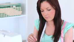 Darkhaired woman sewing Footage