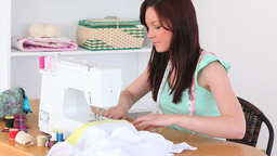 Young brunette sewing Footage