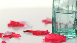 Massage lotion and petals turning Footage