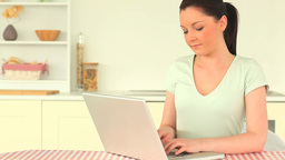 Beautiful woman relaxing with her laptop Footage