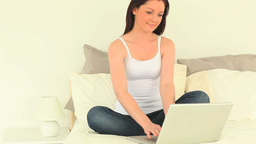 Beautiful woman relaxing with her laptop while sit Footage
