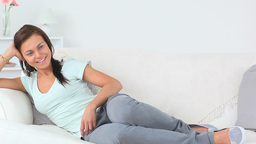 Young Beautiful Woman Having A Rest While Lying On stock footage
