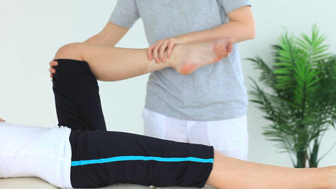 Woman doing some exercises helped by a physiothera Footage