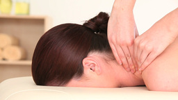 Darkhaired woman receiving a massage while lying o Footage