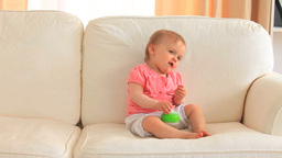 Baby eating on a sofa Stock Video Footage