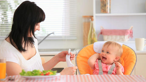 Young mother feeding her daughter Stock Video Footage