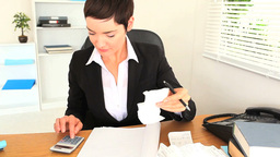 Brunette woman working with a calculator Stock Video Footage