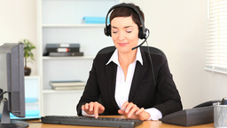 Brunette woman working with a computer Stock Video Footage