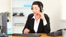Brunette woman working with a computer Footage