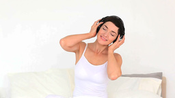 Brunette woman listening to music Footage