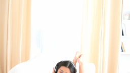 Cheerful brunette listening to music Stock Video Footage