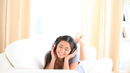 Cheerful brunette listening to music Footage
