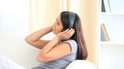 Cute woman listening to music Footage
