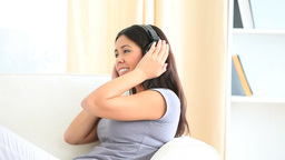 Cute woman listening to music Stock Video Footage