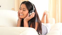 Cute woman enjoying some music Footage