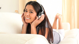 Cute woman enjoying some music Stock Video Footage
