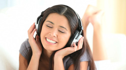 Charming woman listening to music Footage