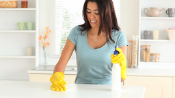 Young woman cleaning her kitchen Stock Video Footage