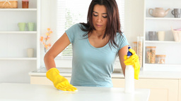 Young woman cleaning her kitchen Footage