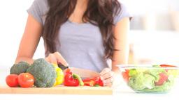 Woman slicing vegetables Footage