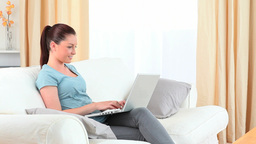 Charming brunette working with her laptop Footage