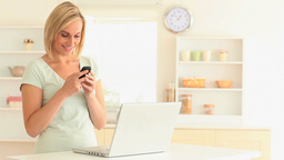 Charming blondhaired woman sending text messages Stock Video Footage