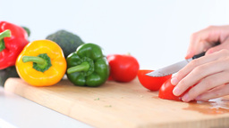 Feminine hands slicing peppers Stock Video Footage