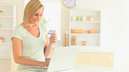 Blondhaired woman paying online Footage