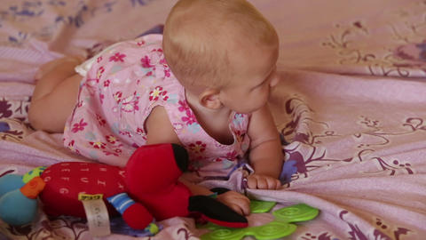 Child Blond In Dress Lying On Bed stock footage