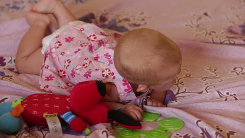 child blond in dress lying on bed Stock Video Footage