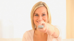 Young woman using a remote Stock Video Footage