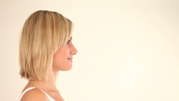 Blonde woman posing in front of the camera Stock Video Footage