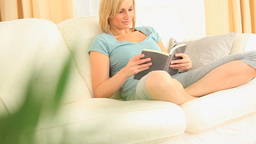 Relaxed woman reading a book Stock Video Footage