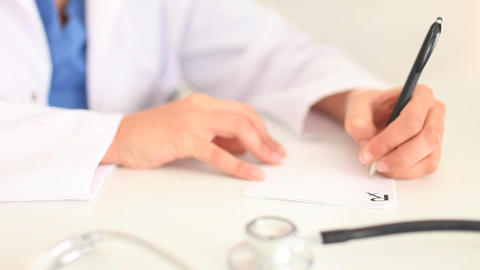 Woman writing a prescription Stock Video Footage