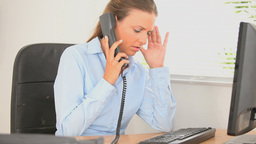 Professional woman getting upset while telephoning Stock Video Footage
